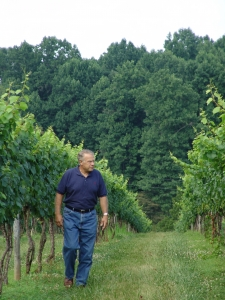 Roger walking the vines